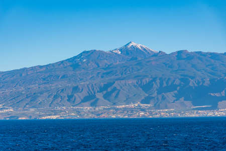 Seaside view of Tenerife dominated by Pico de Teide volcano, Canary islands, Spain. Stock Photo