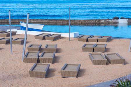 Sun Lounges at Playa de las americas at Tenerife, Canary islands, Spain. Stock Photo