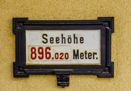 SEMMERING, AUSTRIA, OCTOBER 3, 2015: sign showing elevation of the railway station in semmering, part of the unesco world heritage site semmeringbahn