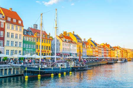 COPENHAGEN, DENMARK, AUGUST 21, 2016: Sunset view of old Nyhavn port in the central Copenhagen, Denmark.