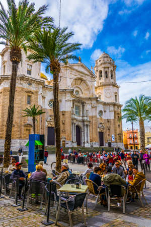 CADIZ, SPAIN, JANUARY 6, 2016: people are relaxing in a cafe on popular plaza de la catedral in cadiz