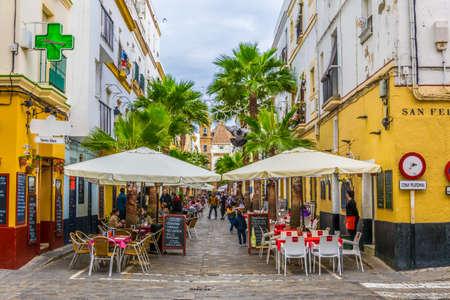 CADIZ, SPAIN, JANUARY 6, 2016: people are enjoying lunch outside on the calle de la virgen in the spanish city cadiz