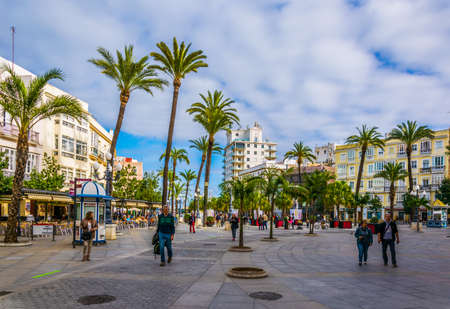 CADIZ, SPAIN, JANUARY 6, 2016: people are strolling over the square of saint john of god in cadiz
