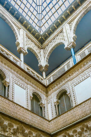 SEVILLA, SPAIN, JANUARY 7, 2016: detail of beautiful carved ornaments inside of the real alcazar palace in the spanish city sevilla. 新闻类图片