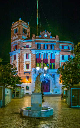 CADIZ, SPAIN, JANUARY 6, 2016: night view of the main post office in the spanish city cadiz which is dominating the plaza topete square