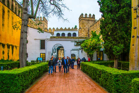 SEVILLA, SPAIN, JANUARY 7, 2016: a group of tourist is entering the royal alcazars palace in the spanish city sevilla