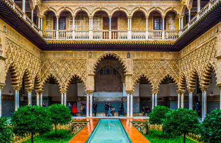 SEVILLA, SPAIN, JANUARY 7, 2016: view of the courtyard of the maidens situated inside of the royal alcazar palace in the spanish city sevilla 新闻类图片