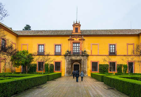 SEVILLA, SPAIN, JANUARY 7, 2016: people are walking over the main courtyard of the real alcazar palace in the spanish city sevilla