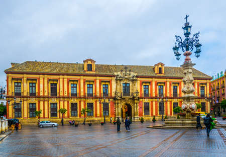 SEVILLA, SPAIN, JANUARY 7, 2016: people are passing by in front of the Archbishop's Palace at Plaza de la Virgen de los Reyes