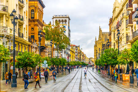 SEVILLA, SPAIN, JANUARY 7, 2016: People are strolling on the avenida de la constitucion street in the spanish city sevilla during a cloudy day in January