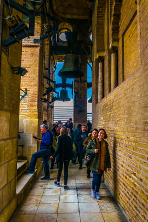 SEVILLE, SPAIN, JANUARY 7, 2016: a group of tourists is passing through la giralda tower in the spanish city sevilla