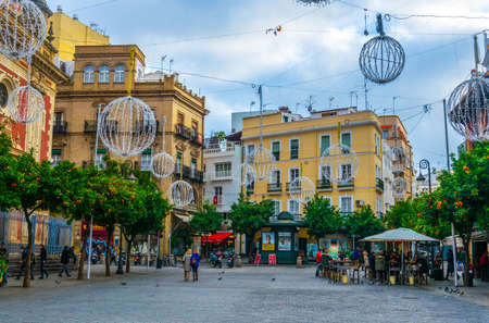 SEVILLA, SPAIN, JANUARY 7, 2016: people are strolling on the plaza del salvador in the spanish city sevilla