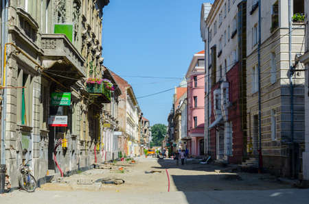 TIMISOARA, ROMANIA, JULY 4, 2015: People are strolling through narrow streets of the old town of Timisoara in romania, which is well preserved city close to hungary.