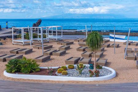 Sun Lounges at Playa de las americas at Tenerife, Canary islands, Spain. Editorial