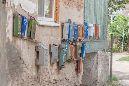 mail slot: Few old mailboxes hanging on the wall