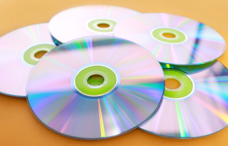 recordable media: DVDs on a yellow background
