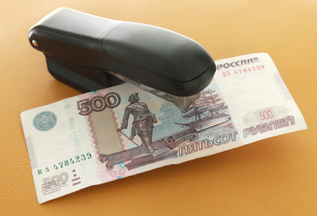 staplers: Money in the stapler Stock Photo