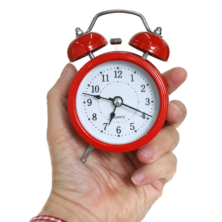 Red alarm clock in hand Stock Photo
