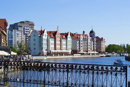 KALININGRAD,RUSSIA - MAY 21, 2017: ethnographic and trade center, embankment of the fishing village, view from Honeymoon bridge