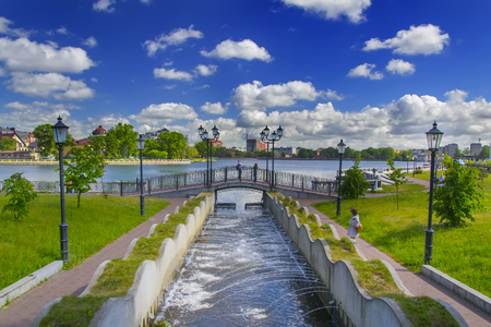 KALININGRAD, RUSSIA - JUNE 1, 2017: the cascade of fountains, the bridge, and views of Top lake in Kaliningrad. The upper lake is one of the most beautiful places in the city