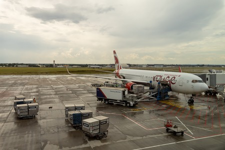 HUNGARY, BUDAPEST - CIRCA 2019: Air Canada Rouge Airline Airplane getting ready for takeoff at Budapest airport, cargo and passengers loading Redakční