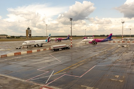 HUNGARY, BUDAPEST - CIRCA 2019: Wizz Air and Eurowings Airline Airplanes getting ready for takeoff at Budapest airport, cargo and passengers loading