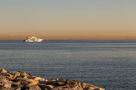 Luxury yacht in ArabianPersian gulf at sunrise with beautiful colors in the sky 版權商用圖片