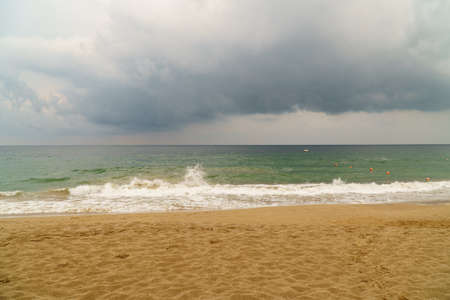 Storm clouds over a rough sea in Fujairah, UAE. Concept of bad weather, hurricane season and storm unstable times