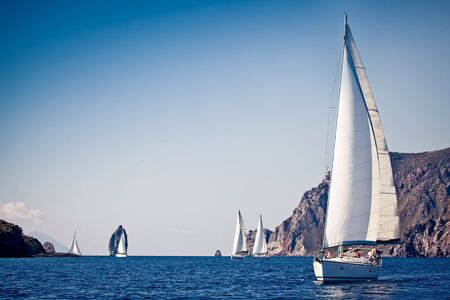 Sailing ship yachts with white sails in a row Reklamní fotografie