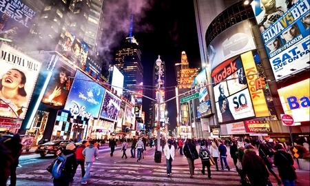 Manhattan, New York City, USA - January 7 2011: Times Square, featured with Broadway Theaters and animated LED signs, is a symbol of New York City and the United States