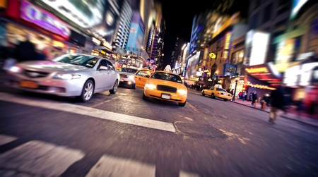 NEW YORK - JANUARY 6: Blurred image of yellow taxi cab on January 6, 2011 in Times Square and 42nd Street, Manhattan, New York City Stock Photo - 11459452