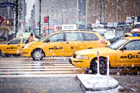NEW-YORK - JANUARY 7: Taxi Cabs cautiously maneuvering through a blizzard on January 7, 2011 in Eight Av, NYC Editorial