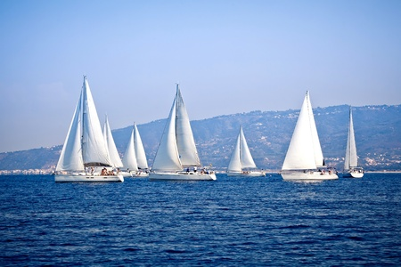 Sailing ship yachts with white sails Stock Photo