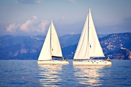 recreation yachts: Sailing ship yachts with white sails Stock Photo
