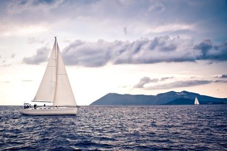 sailboat: Sailing ship yachts with white sails Stock Photo