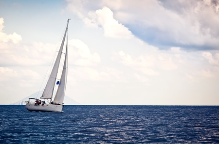 Sailing ship yacht in open sea Stock Photo