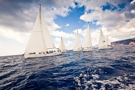 outdoor pursuit: Sailing ship yachts with white sails Stock Photo