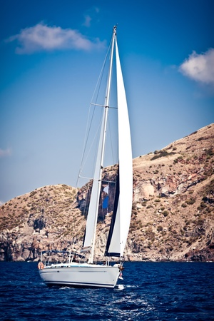 speed boat: Sailing ship yacht in open sea Stock Photo