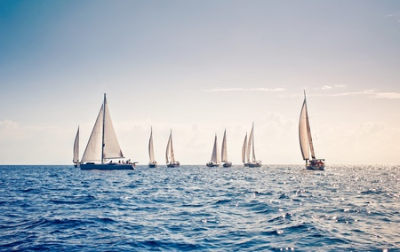bow of boat: Sailing ship yachts with white sails Stock Photo