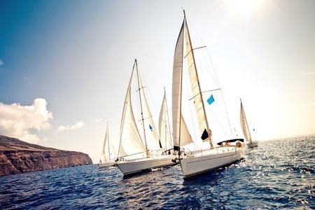 sailing crew: Sailing ship yachts with white sails Stock Photo