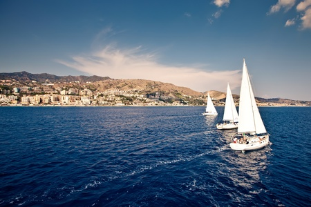 boat crew: Sailing ship yachts with white sails Stock Photo