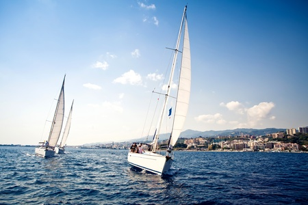 sail boat: Sailing ship yachts with white sails Stock Photo