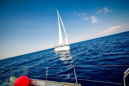Sailing ship yacht in open sea photo