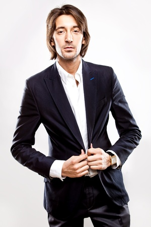 Young serious man in suit photo