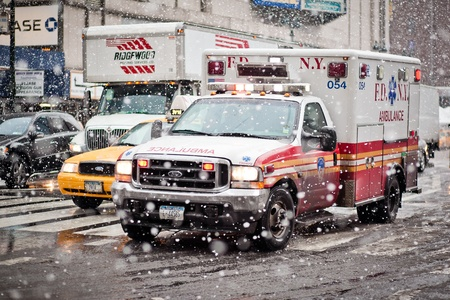 NEW-YORK - JANUARY 7: Ambulance car cautiously maneuvering through a blizzard on January 7, 2011 in Seventh Av, NYC