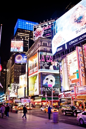 Manhattan, New York City, USA - January 11 2011: Times Square, featured with Broadway Theaters and animated LED signs, is a symbol of New York City and the United States