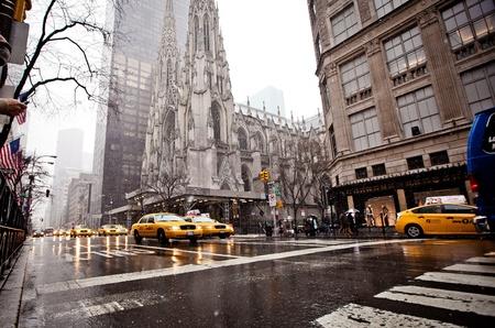 yellow cab: NEW YORK - JAN 7: City streetlife on Fifth Av. near St. Patrick Cathedral on January 7, 2011 in Manhattan, New York City