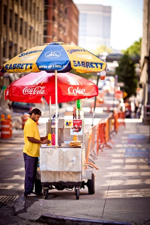 NEW YORK, USA - Hot Dog stand in Washington street in Brooklyn selling hot dogs, pretzels and drinks on July 2, 2011 in New York, USA. Buildings on the background Editorial
