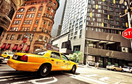 NEW YORK CITY - JULY 2: Riding yellow taxi cab on July 2, 2011 in New York City. Taxicabs with their distinctive yellow paint, are a widely recognized icon of the city.