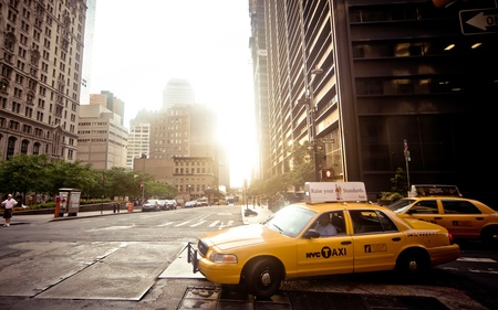 taxicabs: NEW YORK CITY - JULY 2: Riding yellow taxi cab on July 2, 2011 in New York City. Taxicabs with their distinctive yellow paint, are a widely recognized icon of the city.